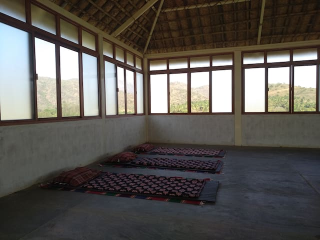 Our light-flooded dormitories have simple mats on the floor and a great view.