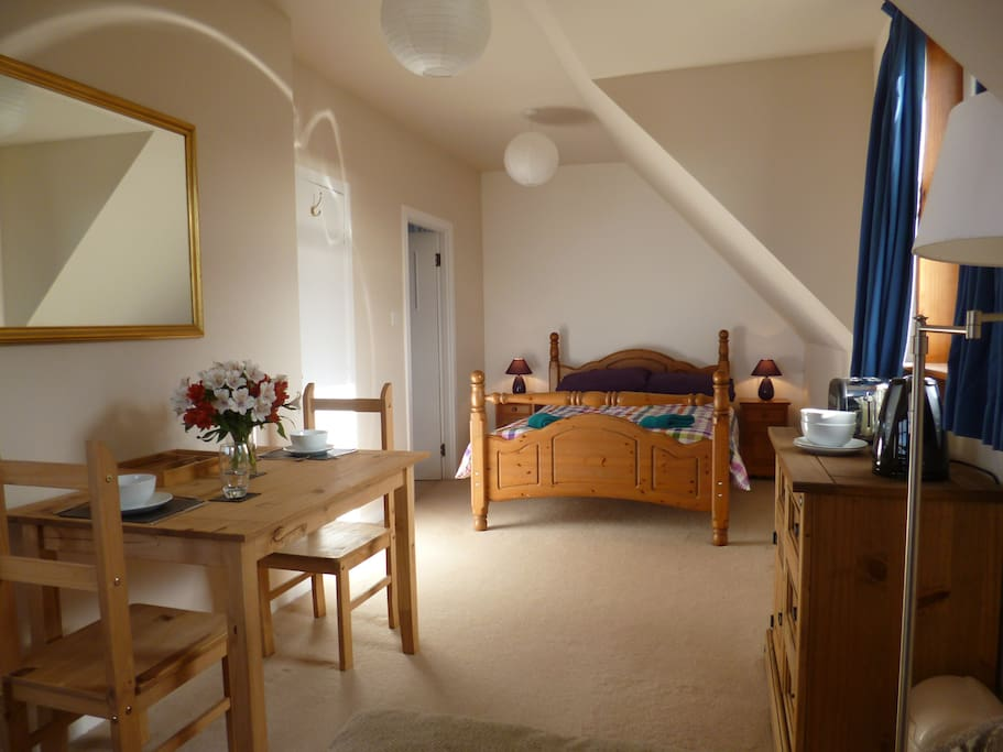 Bright, big bedroom with dining area and en-suite.