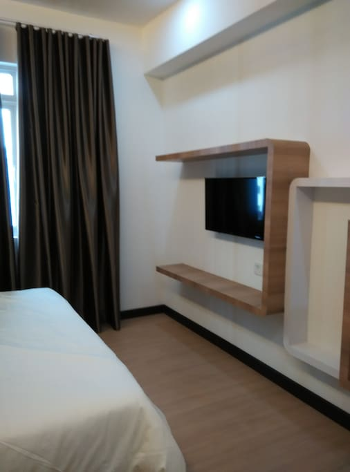 Master bedroom with TV set