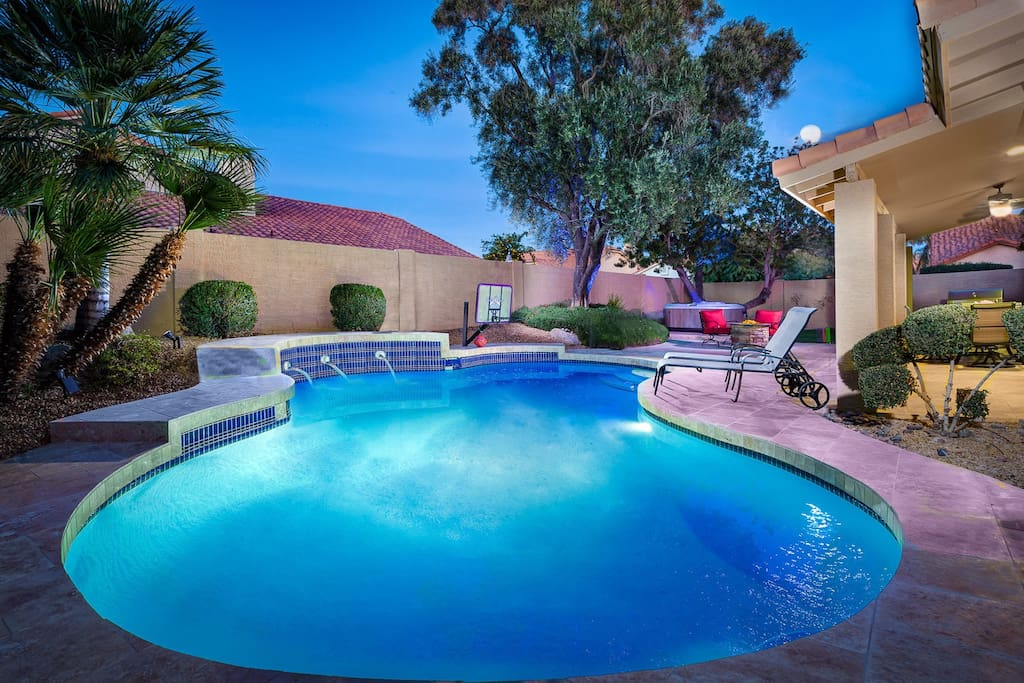 Beautiful backyard with heated pool, brand new spa, grill, and firepit