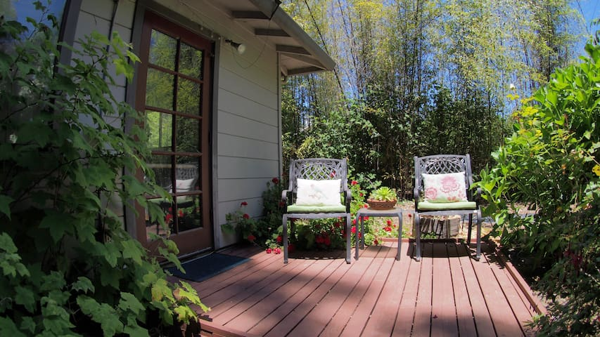 Your Patio & private side entrance - Guests often tell us the property is more beautiful than the photos can show!