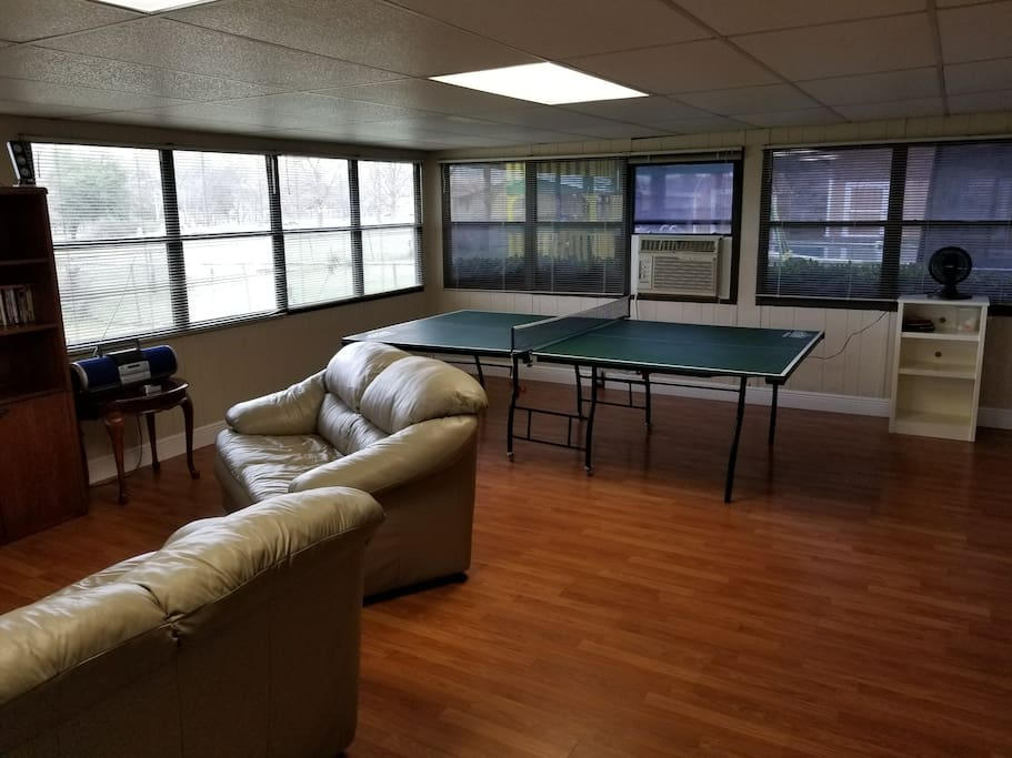 Sunroom with Ping Pong table, movies, and games.  Perfect hangout for the family or the kids.