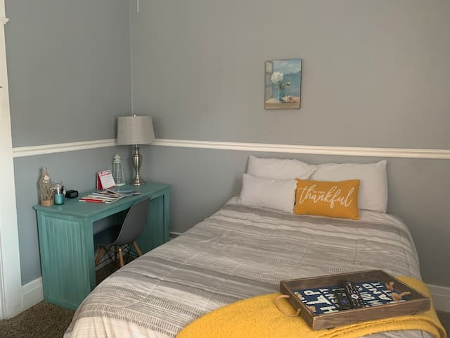 First bedroom with a full bed