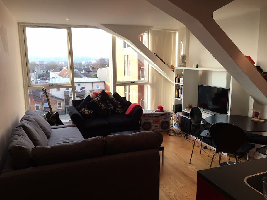 Lounge with great views (cloudy day pic), TV, sofa bed, games consoles, dining table.