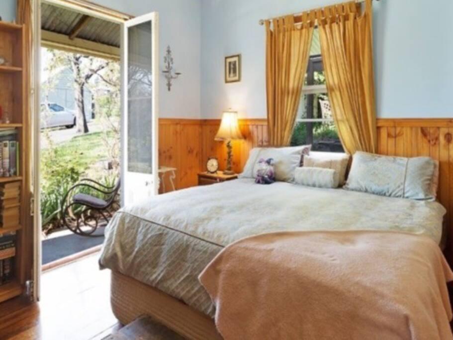 Front bedroom with French Doors opening onto verandah.