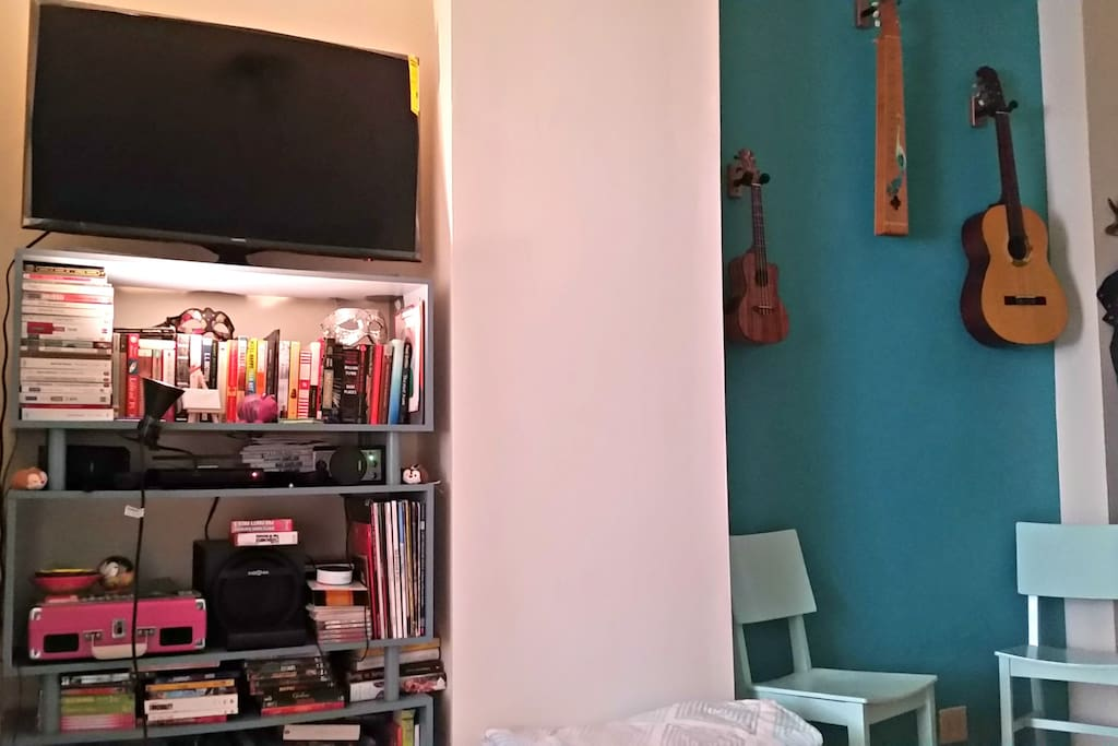 Our TV is a smart TV - we do not have a cable subscription but it is linked to YouTube, HBO Now, Amazon Video and Pandora. We also have an Amazon Echo Dot, so you can ask her to play some tunes while you get ready for NYC excursions! Next to this is a small nook which now houses a triangular breakfast table (not pictured) between the two chairs.