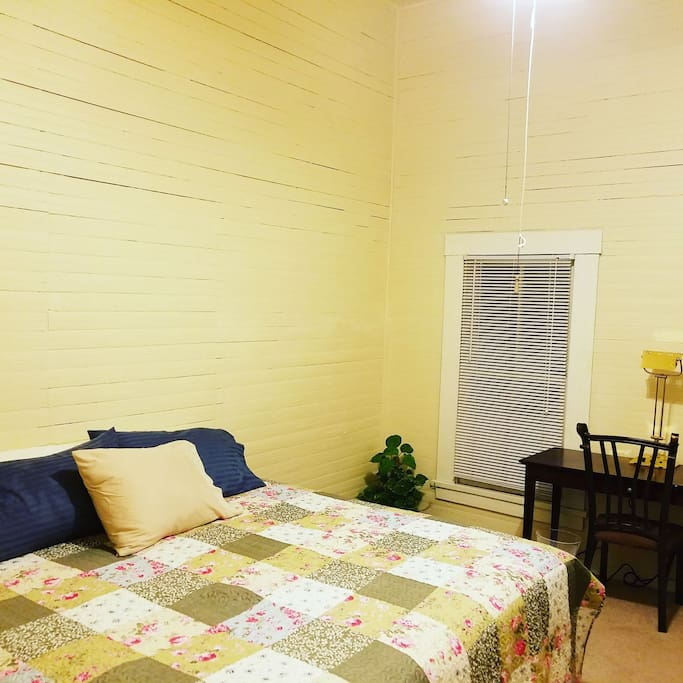 come relax in this comfy king size bed, this room also has a desk and a full closet!