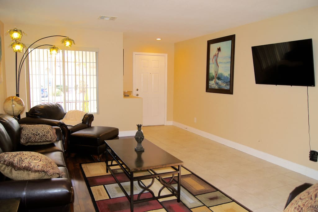 Living Room 50' UHD TV and entry door