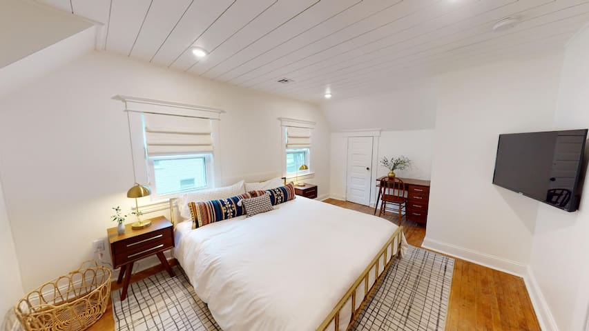 The master bedroom has a king bed, TV, blackout window treatments and a huge closet that conveniently fits a Pack 'n Play for any little travelers.