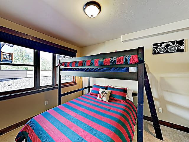 The 2nd bedroom features a twin-over-queen bunk bed.