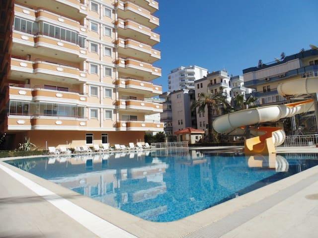 Квартира 2+1 с видом на море , бассейном и горками - Alanya - Flat