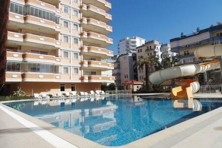 Квартира 2+1 с видом на море , бассейном и горками - Alanya - Serviced apartment