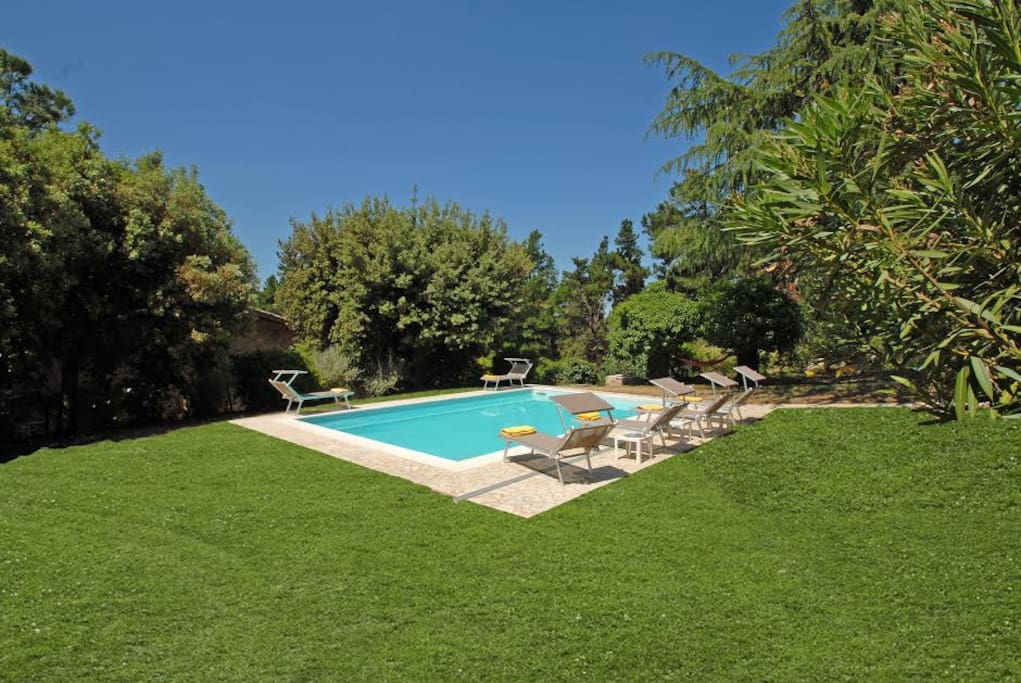 The private heated swimming pool of villa Miralaghi