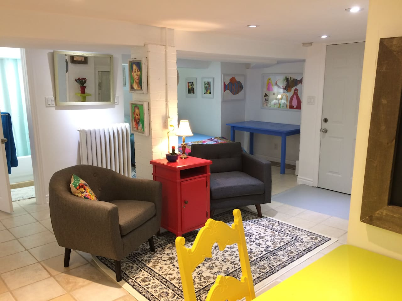 Lots of colour, beautiful artwork and 2 large sofa chairs to relax,  in the heart of the city after a walk through nearby Gage Park. This apartment has it's own thermostat and vintage cast iron radiator to warm up on chilly nights.