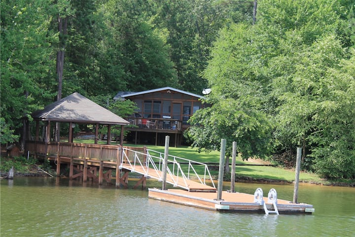 Lakefront & dog-friendly home w/ dock, paddle boat, and lake views!