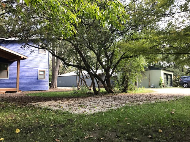 There's a dedicated parking space at the front of the house - please park on the gravel. Our green garage is pictured in the background.