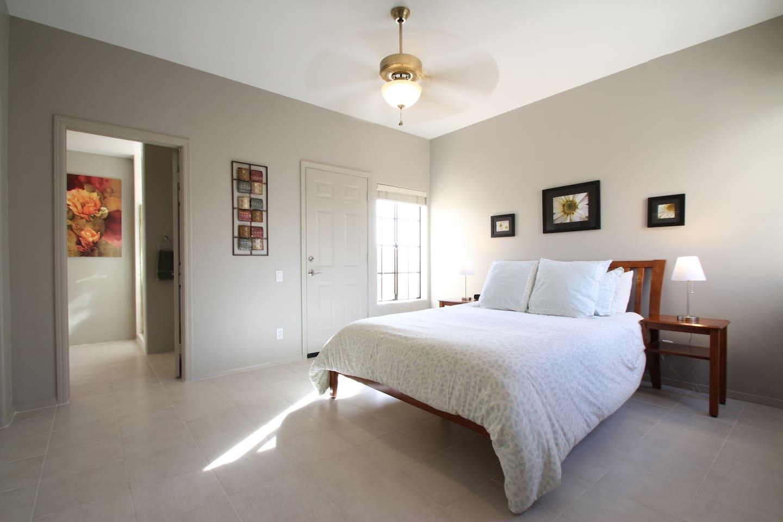 spacious bedroom with door to back patio