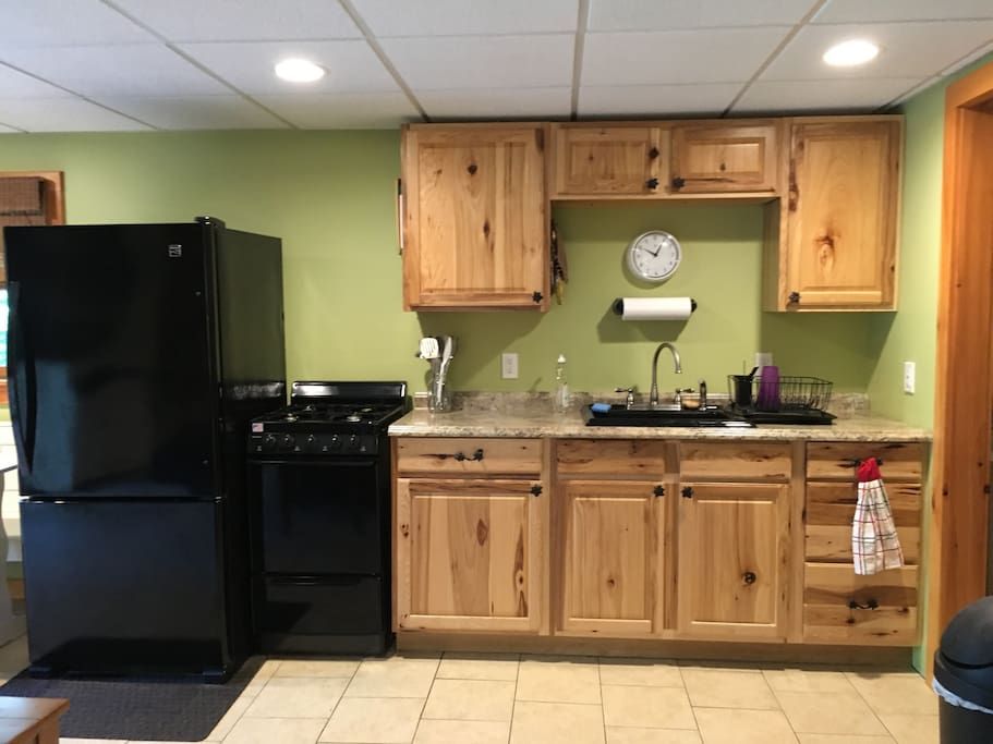Kitchenette with refrigerator, gas range, sink