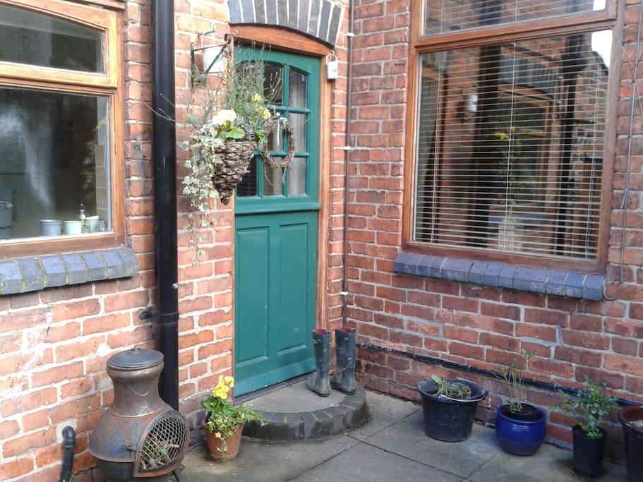 Rear patio area and main entrance