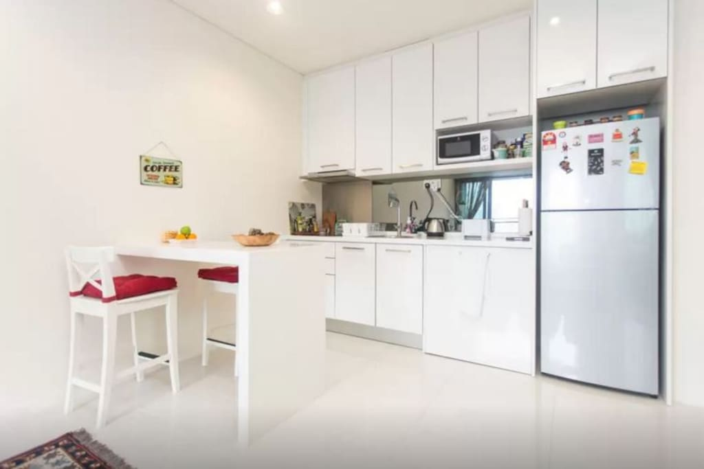Kitchen and dining area with breakfast bar for efficient people on the go