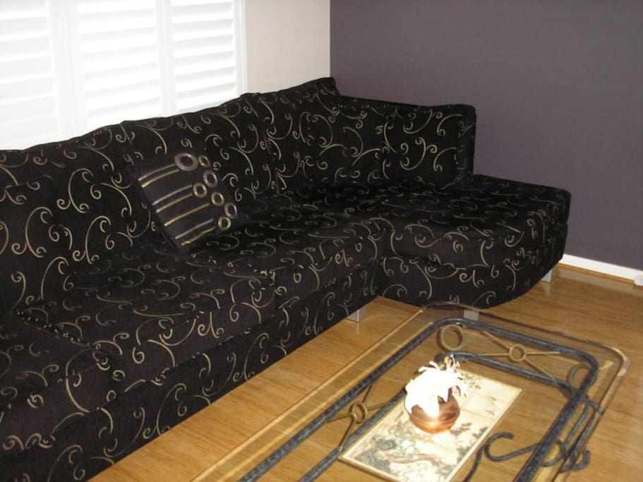 Large spacious comfy couch in TV room