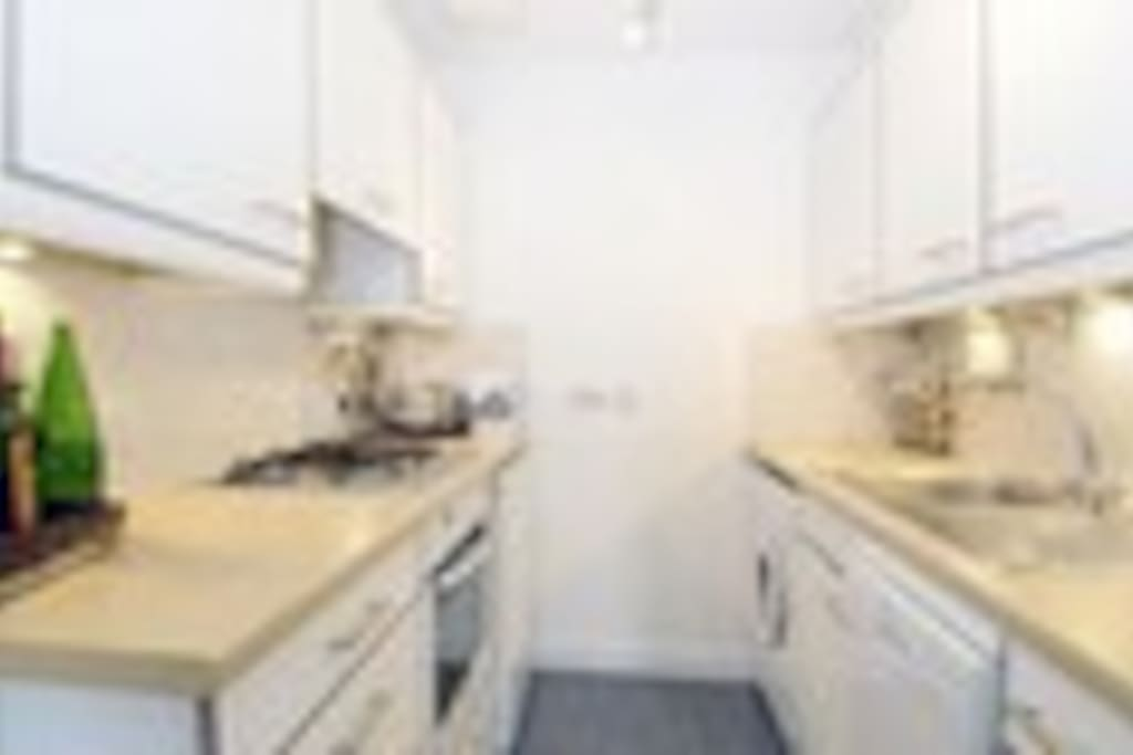 Kitchen with dishwasher and washer/dryer