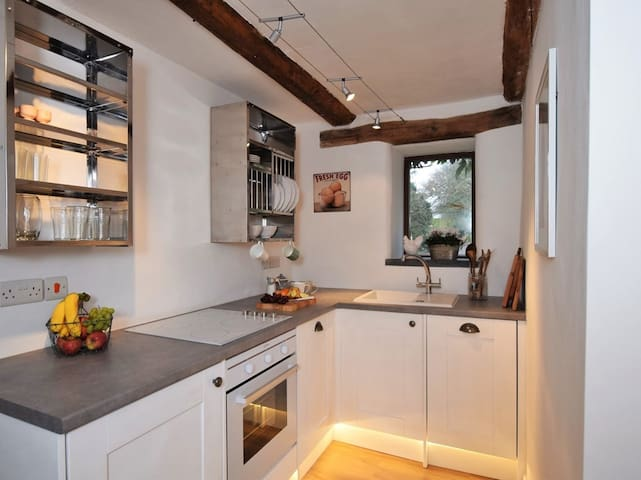Simple shaker style kitchen with modern touches, including integrated dishwasher