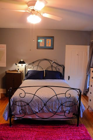 Bedroom has queen bed, smart TV, wifi, window A/C, gas and electric space heaters, closet.