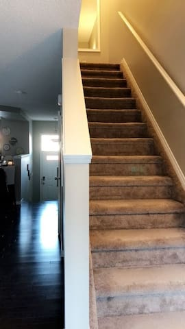 A view of the entrance to the unit and the Stairs that will take you to your room.