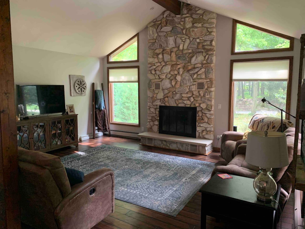 Living room with gas fireplace.  Great views to wooded lots across the street.  Lots of wildlife!