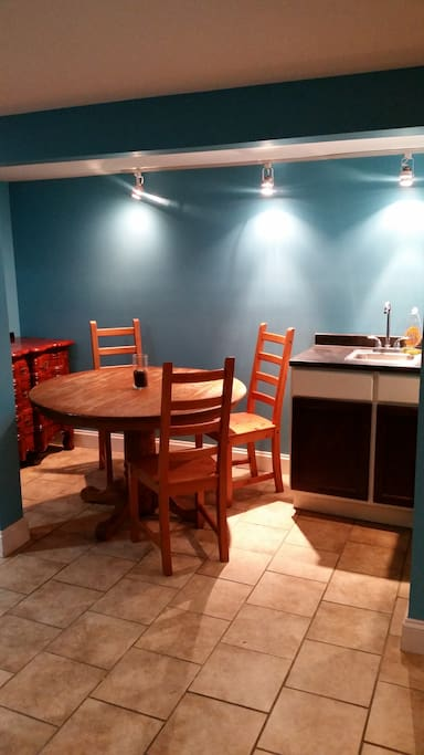 Kitchenette with dining room table.