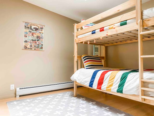 The second bedroom on the second floor (next to the master): kids' camping themed hideaway! Complete with organic linens and Crate and Kids' furnishings.