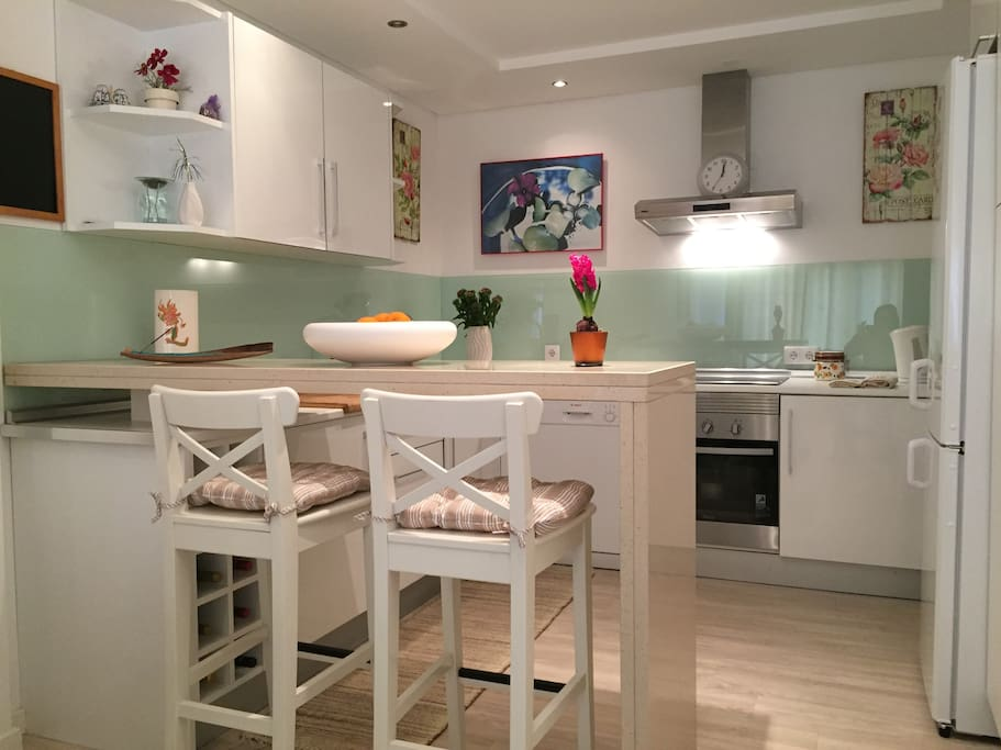 Fully furnished kitchen with dining area