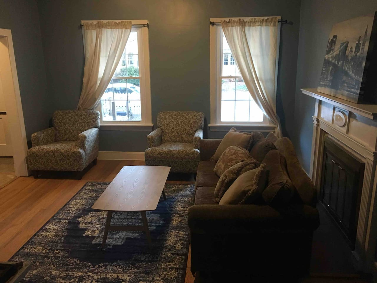 Comfortable living room with pull out queen sleeper sofa.