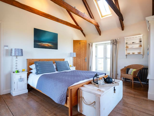 Triple aspect Master bedroom with Kingsize bed and ensuite shower room and vaulted ceiling