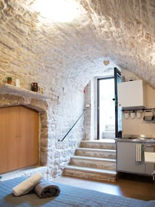 Small white stone house.