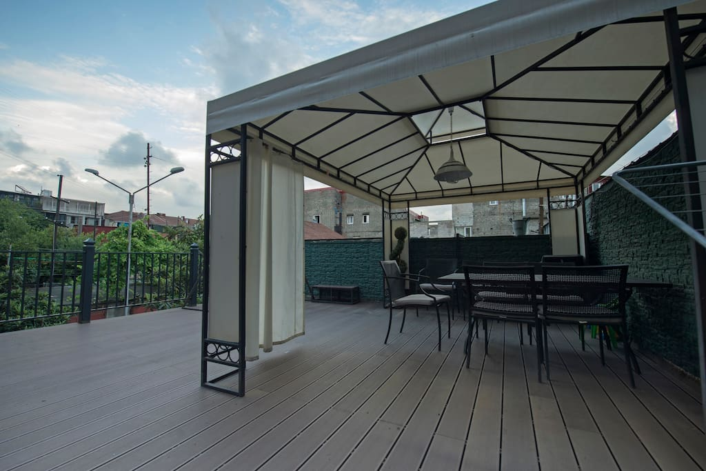 The apartment has a very big  balcony about 40 m2 square with modern furniture and a pavilion where you can spend pleasant evenings. For the families who have children we have also a swing on our balcony.