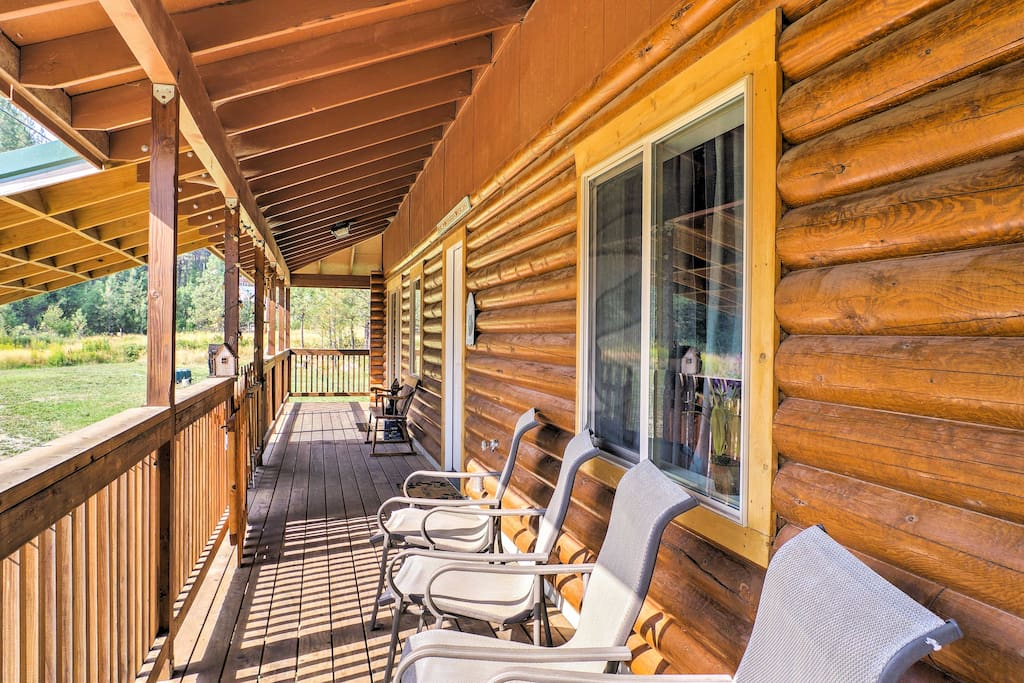 Enjoy the fresh air from this beautiful wraparound deck.