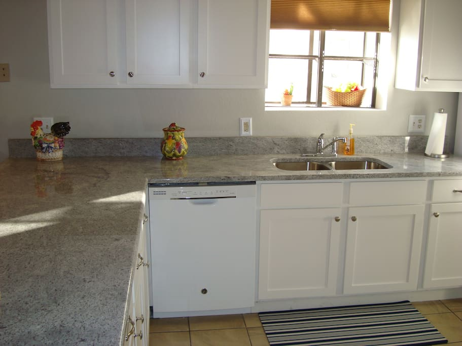 Recently updated granite countertops and fresh cabinets.  Keurig and many small appliances for family convenience.
