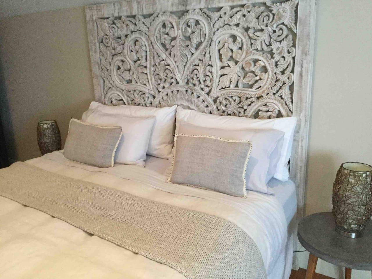 King size super luxurious bed . French linen sheets decadent mattress topper and fluffy light duvet . In a huge bedroom with en-suite drenched in northern light .