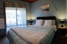 Main bedroom with comfy queen size bed and electric blanket with fleece top