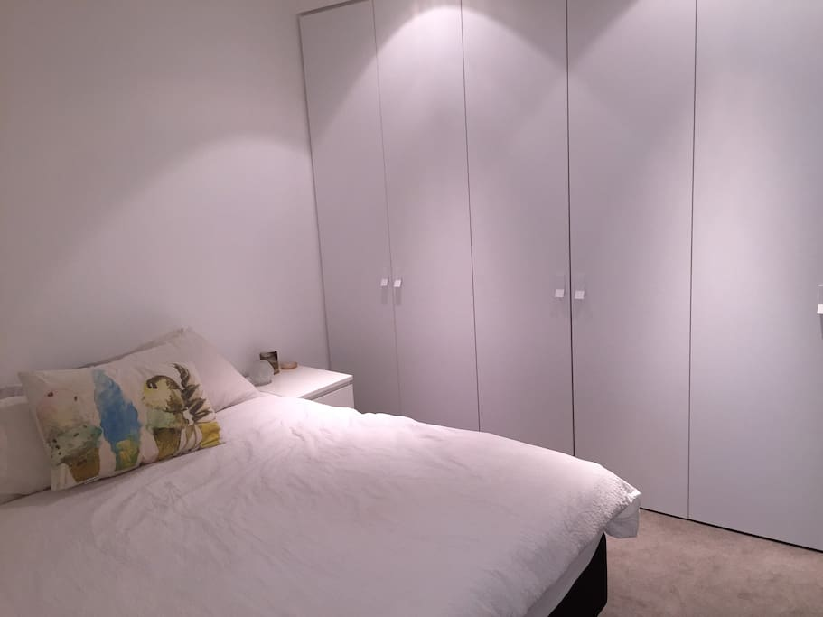 King-size bed with built in wardrobe - 1x will be emptied for you to place clothing