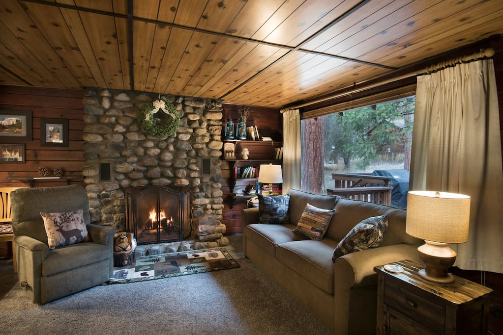 Living room with beautiful rock fireplace