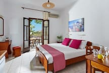 Studio for 2, with one extra comfortable double bed or two singles beds and pool view.