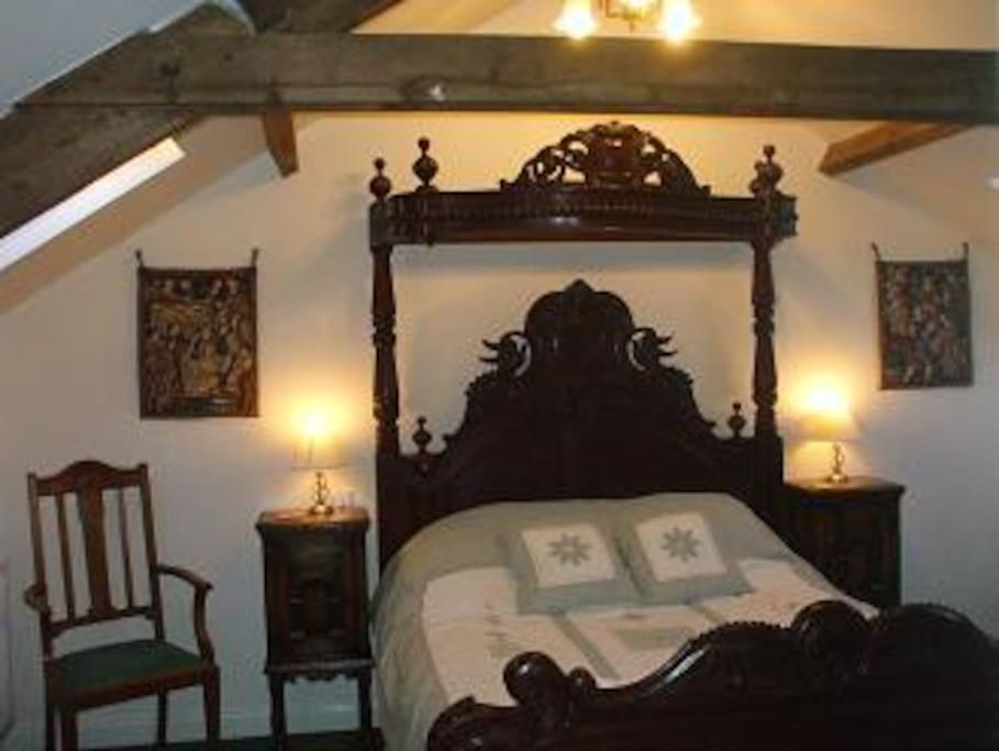 The Hayloft, with king size antique bed.