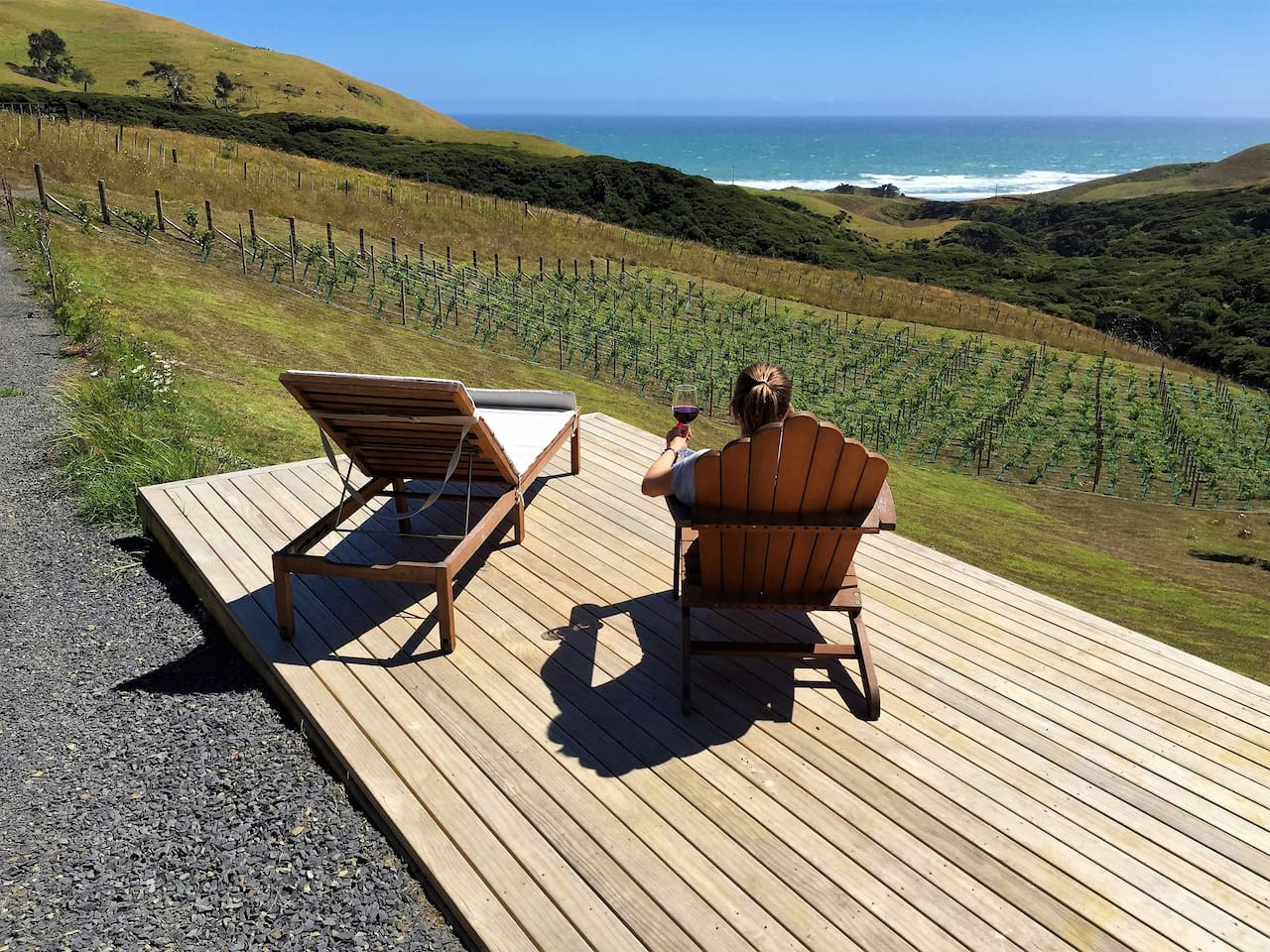 Enjoy a wine on the vineyard viewing deck overlooking the vineyard out to sea!