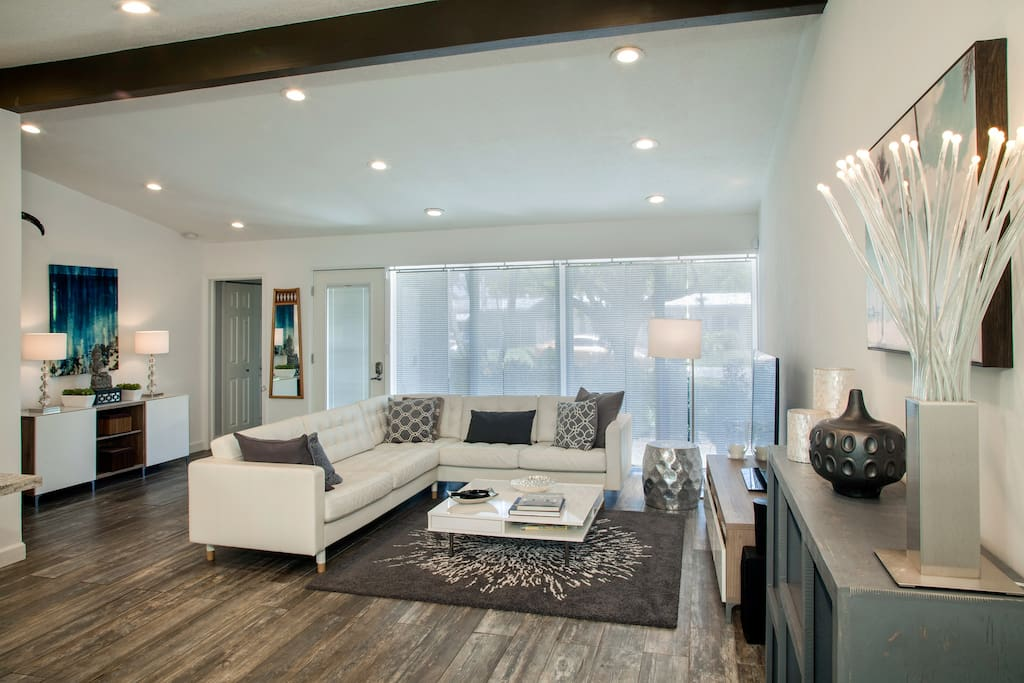 Tall ceilings and chic furnishings in the open concept living space.