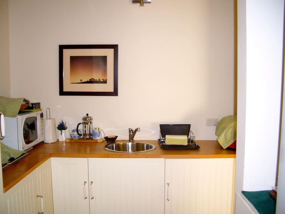 Kitchenette, frig, microwave  toaster  cutlery, crockery, tea coffee etc.