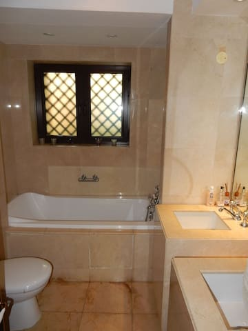 bathroom - which has bath tub & shower