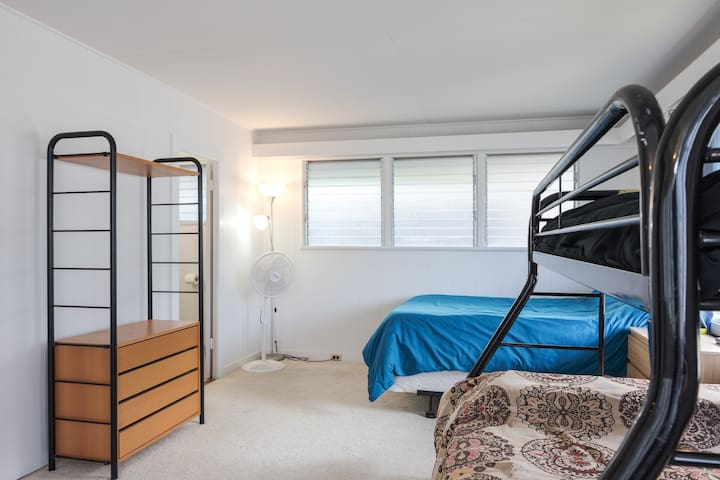 Your private bedroom comes with a queen-sized bed and a twin/full bunk bed